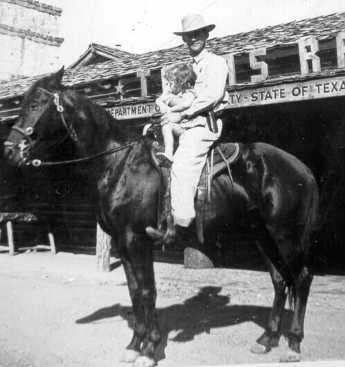 Texas Ranger Dub Naylor and child in front of Co. B Headquarters in Fair Park, Dallas
