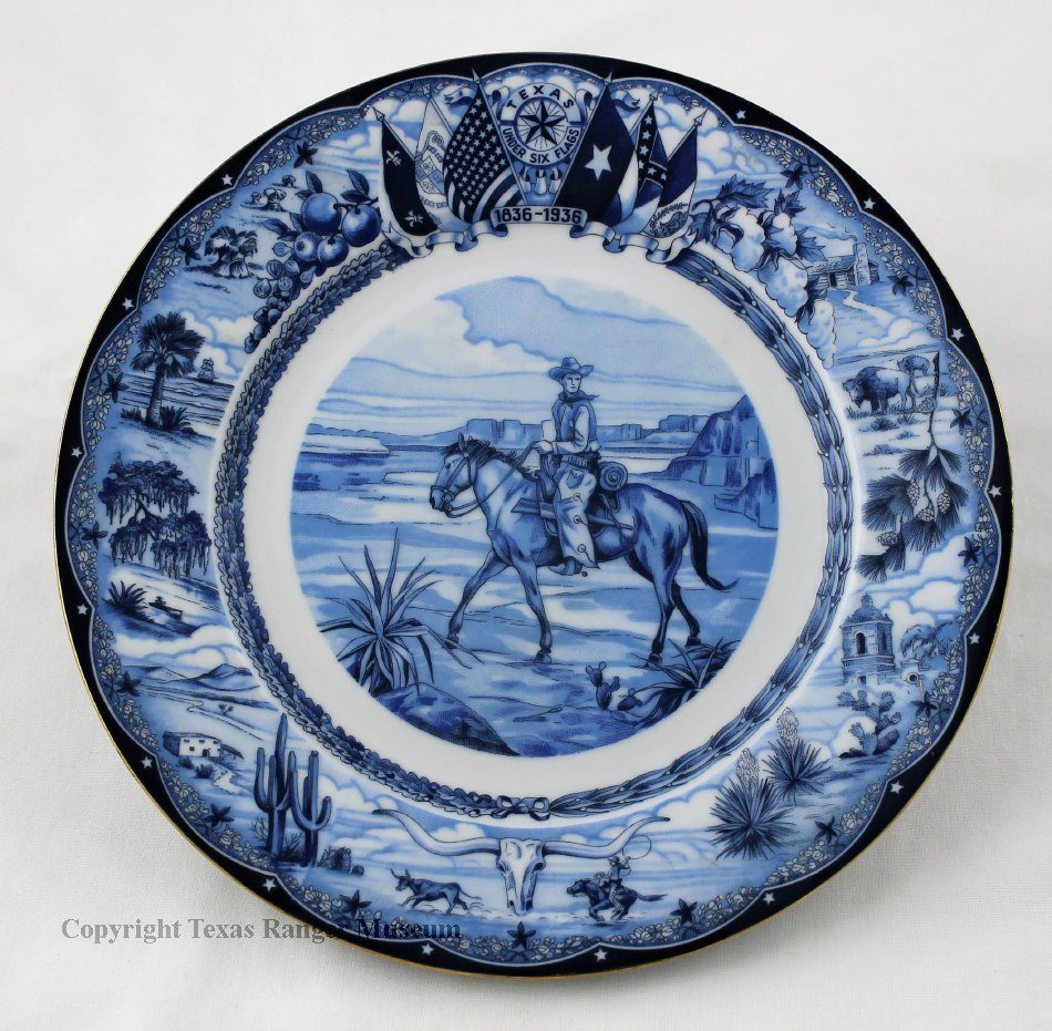 A blue inked white china plate with a cowboy on a horse in the middle, various Texas scenes along the edges, and the six flags of Texas at the top.