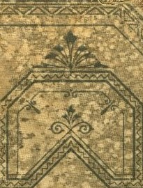 A tan surface with blue/black geometric designs on it.