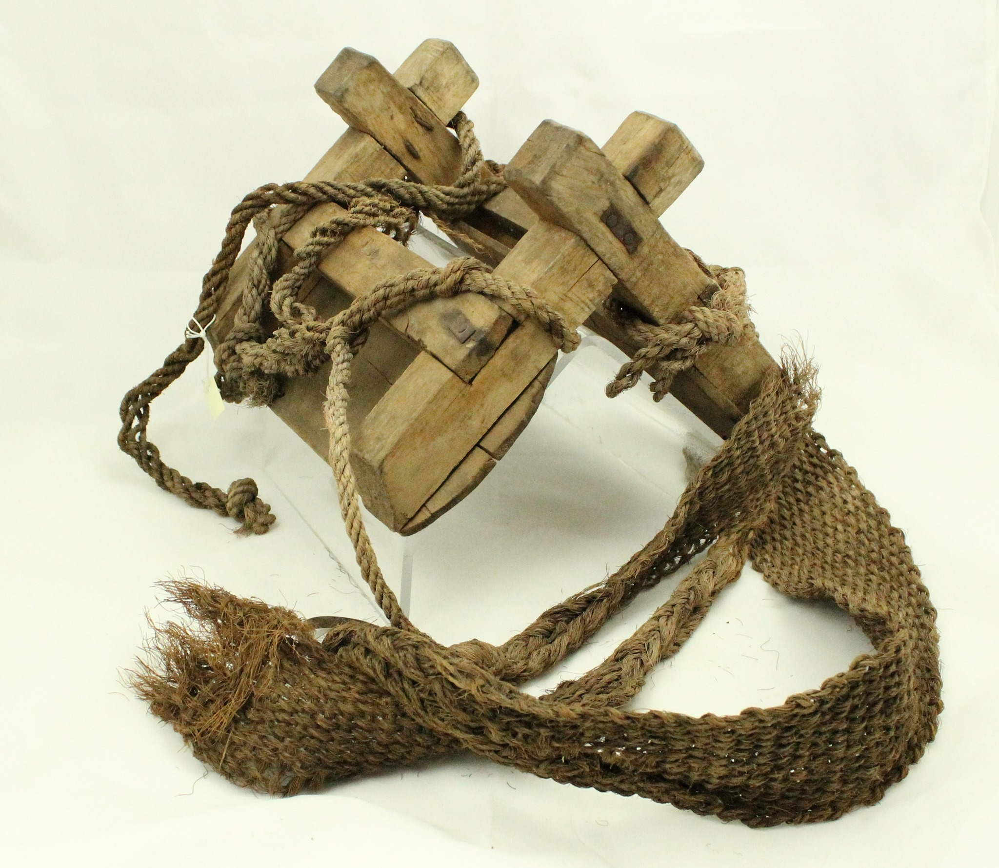wood tent shaped pack saddle with leather ropes