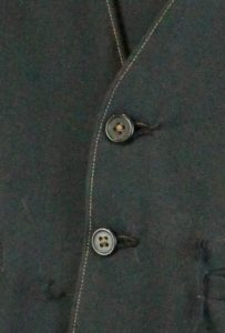 soft black fabric with two buttons