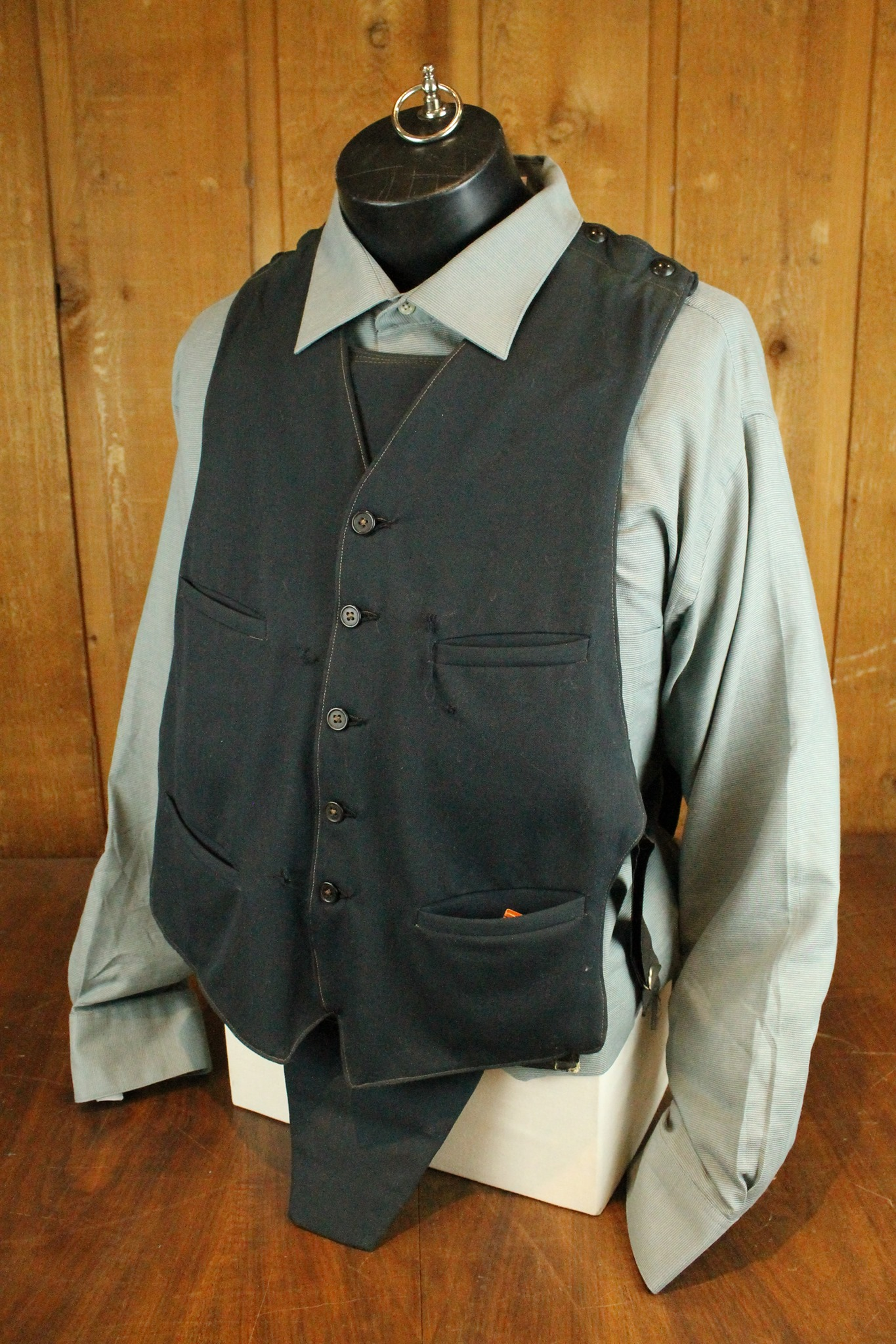 soft black vest with 5 buttons and 4 pockets