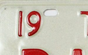 red number 19 and hole on white metal plate